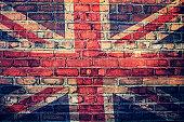 Union Jack flag on  brick wall