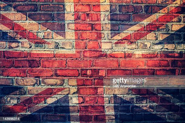 Union Jack flag on  brick wall