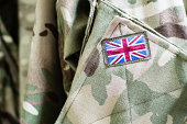 Union Jack flag on the sleeve of British military camouflage uniform shirt sleeve