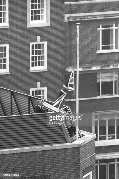 A Union Jack hoisted up in advance of the Queen's birthday is raised to halfmast on a building adjoining the Libyan People's Bureau in St James's...