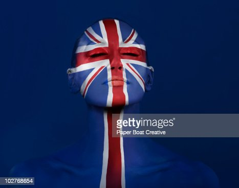 Union Jack painted on woman's face : Stock Photo