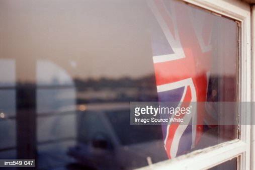 Union Jack seen through a window : Stock Photo