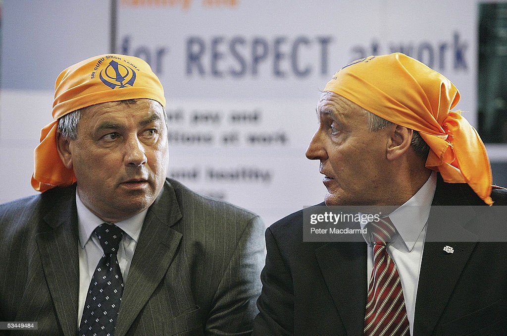Union leaders Brendan Barber of the Trades Union Congress and Tony Woodley of the Transport and General Workers Union wear head scarves as they meet...