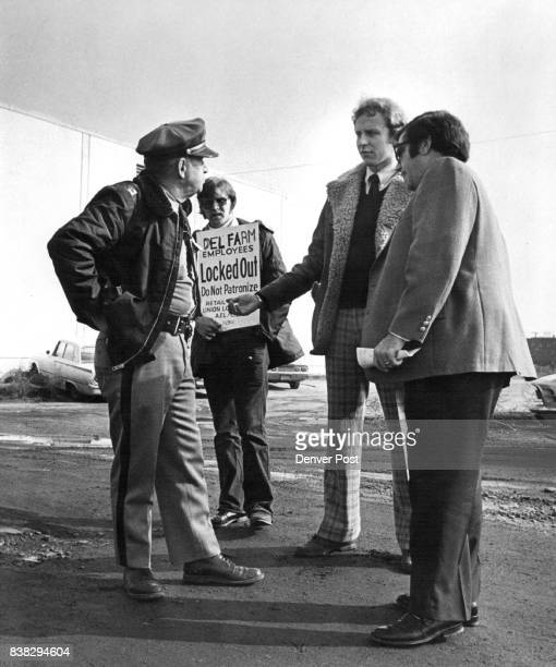Union Leaders Ed Finkelstein right and Bryan Gish Talk to Guard L W Dennis Looking on in the background is picket Tom Masterson who claimed he was...
