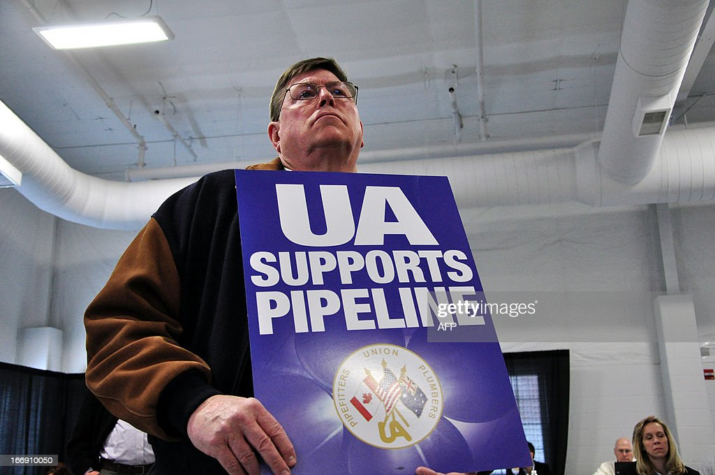 A union member attends a public hearing on the Keystone Pipeline on April 18, 2013 in Grand Island, Nebraska. Supporters and opponents of the extension of the Keystone Pipeline, which could carry oil from Canada to the Gulf of Mexico, have publicly clashed in Nebraska, where the project is very controversial because of its potential impact on the environment. AFP PHOTO/Guillaume Meyer