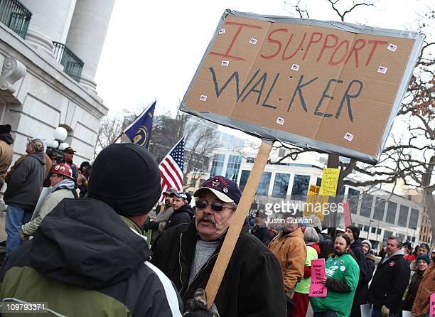 A union member confronts a supporter of Wisconsin governor Scott Walker during a large march and rally at the Wisconsin State Capitol on March 5 2011...