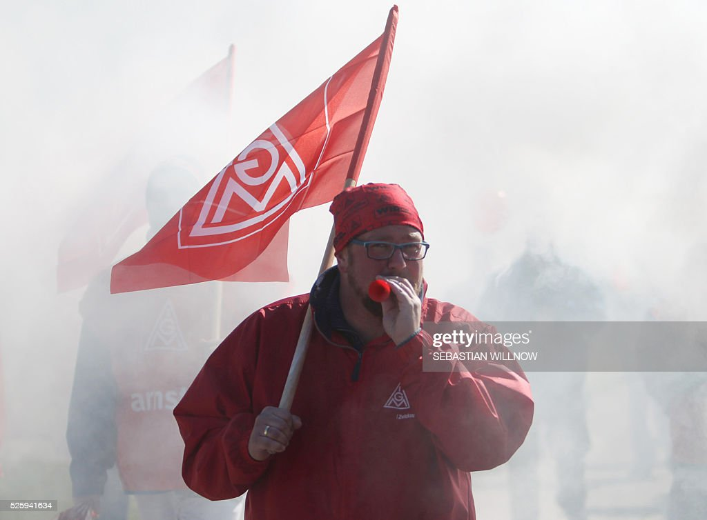 A union member takes part in a warning strike initiated by German union IG Metall on April 29, 2016 at the Volkswagen plant in Zwickau, eastern Germany. The powerful German union IG Metall organised a series of warning strikes overnight, hitting the automobile sector in particular, to turn up heat in wage negotiations for around 3.4 million metal sector workers across the country. / AFP / dpa / Sebastian Willnow / Germany OUT