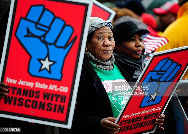 Union members and supporters rally outside New Jersey's Statehouse calling for an end to Governor Chris Christie's benefit cuts in what they see is a...