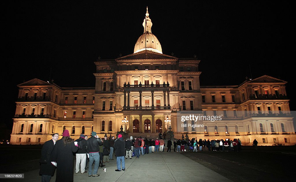 Union members from around the country line up early to enter the Michigan State Capitol where a vote on RighttoWork legislation is scheduled to be...