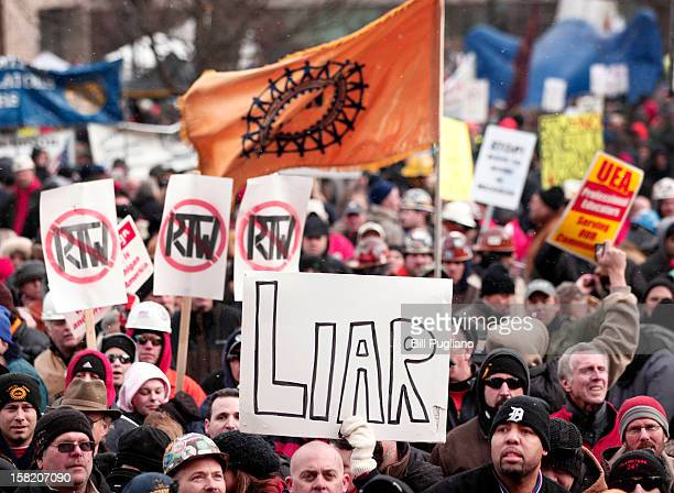 Union members from around the country rally at the Michigan State Capitol to protest a vote on RighttoWork legislation December 11 2012 in Lansing...