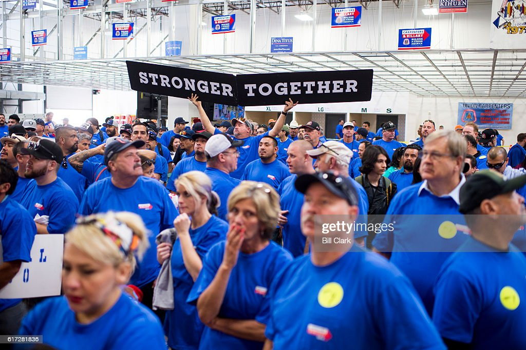 Union members gather to listen to Democratic candidates speak at the United Brotherhood of Carpenters early vote rally at the Carpenters Union Training Center in Las Vegas on the first day of early voting in Nevada on Saturday, Oct. 22, 2016.