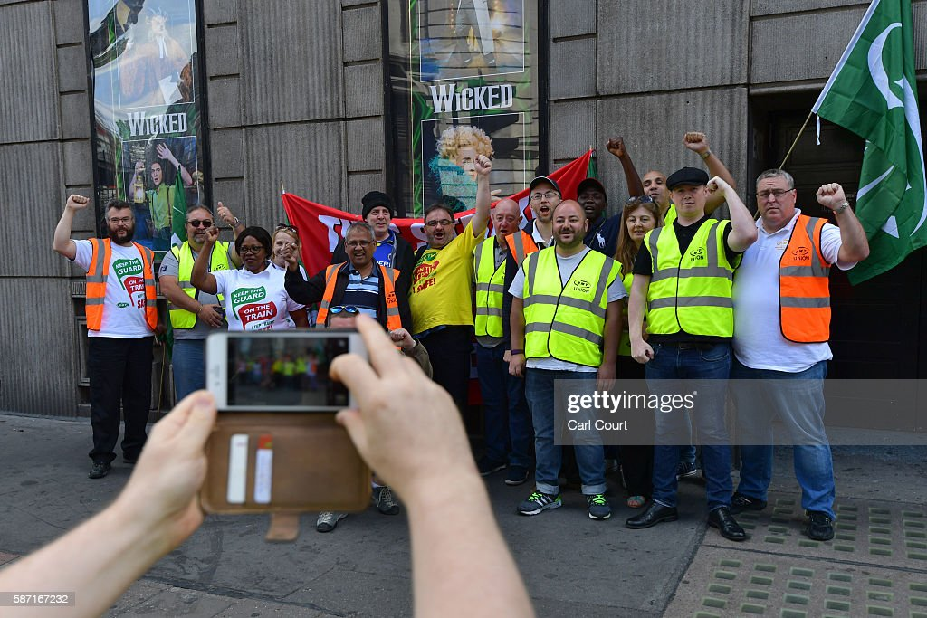 Union members have their photograph taken as they man a picket line at Victoria station on August 8 2016 in London England Hundreds of thousands of...