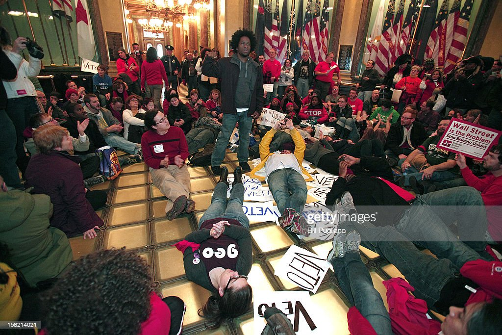 Union members hold a sit-in in the rotunda of the Michigan State Capitol to protest a vote on Right-to-Work legislation December 11, 2012 in Lansing, Michigan. Republicans control the Michigan House of Representatives, and Michigan Gov. Rick Snyder has said he will sign the bill if it is passed. The new law would make requiring financial support of a union as a condition of employment illegal.