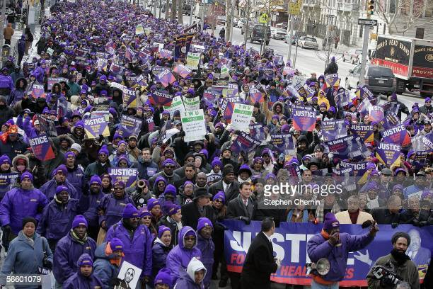 Union members march up Adam Clayton Powell Blvd during a rally January 16 2006 in New York City Hundreds of 1199 SEIU healthcare workers rallyed for...
