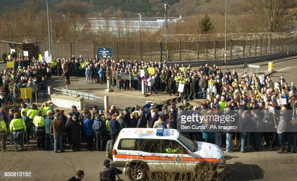 Union members stage a demonstration and block traffic outside the gates of Faslane naval base the home of Britain's nuclear submarine fleet on the...