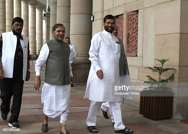 Union Minister and Lok Janshakti Party leader Ram Vilas Paswan with JD leader Sharad Yadav and RPI President Ramdas Athawale arrives for the All...