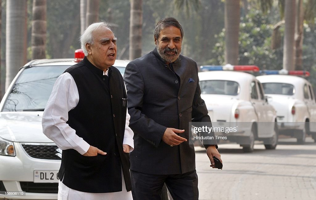Union Minister for Commerce and Industry and Textiles, Anand Sharma and Communications & IT Minister Kapil Sibal at Parliament House during the winter session, on November 23, 2012 in New Delhi, India.