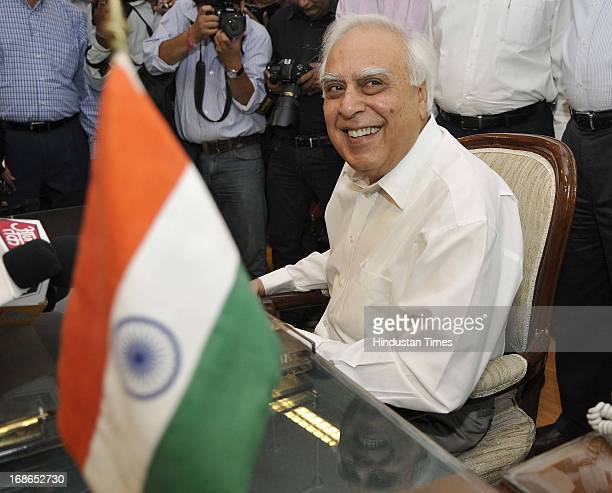 Union Minister for Communications and Information Technology Kapil Sibal addressing the media after taking additional charge of Law Ministry on May...