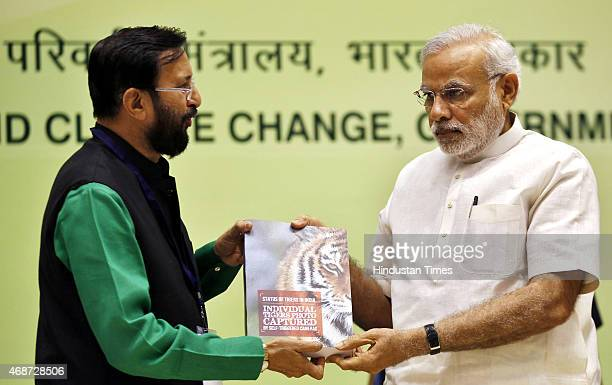 Union Minister for Environment Forest and Climate Change Prakash Javadekar presents a copy of the latest Tiger census report to Prime Minister...
