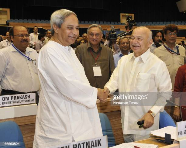 Union Minister for Home Affairs Sushilkumar Shinde shakes hands with Odisha Chief Minister Naveen Patnaik at the inaugural session of Conference of...