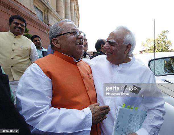 Union Minister for Micro Small and Medium Enterprises and BJP Leader Kalraj Mishra with Congress leader Kapil Sibal at the Parliament during Budget...