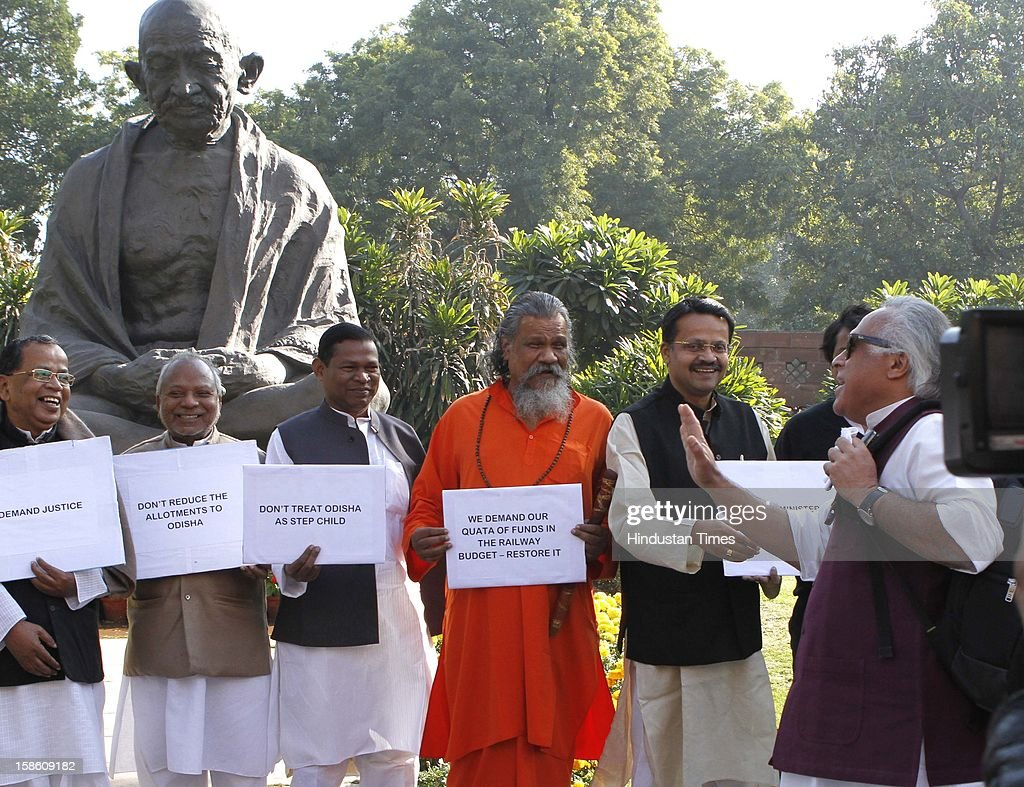Union Minister for Rural Development Jairam Ramesh looks on as BJD MPs protesting against reducing railways budget for Odisha at Parliament house during the last day of Parliament's winter session on December 20, 2012 in New Delhi, India.