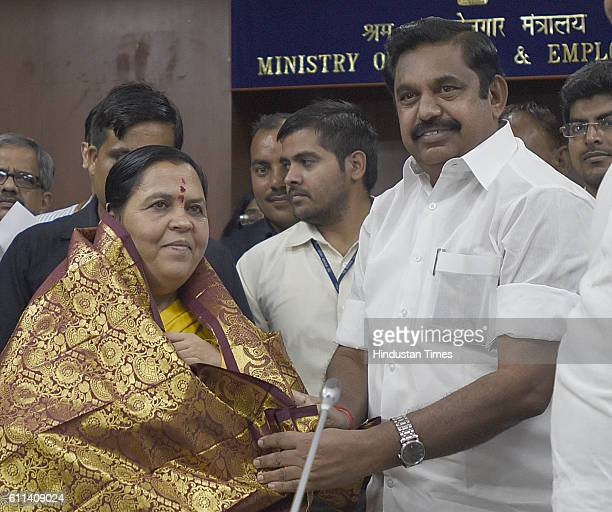 Union Minister for Water Resources Uma Bharti and Edappadi K Palanisamy PWD Minister of Tamil Nadu during a meeting on the issue of Cauvery at Sharam...