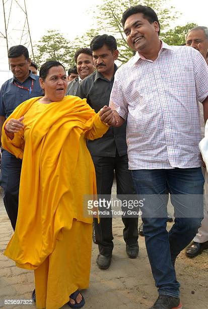 Union Minister for Water Resources Uma Bharti with Delhi Tourism Minister Kapil Mishra after Flag off the first Trash Skimmer for surface cleaning of...
