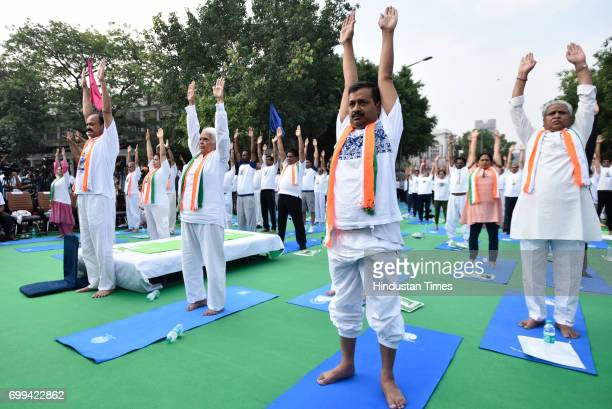 Union Minister M Venkaiah Naidu and Delhi Chief Minister Arvind Kejriwal along with other ministers during the International Day of Yoga celebrations...