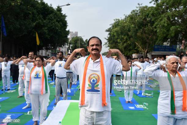 Union Minister M Venkaiah Naidu during the International Day of Yoga celebrations at Connaught Place on June 21 2017 in New Delhi India