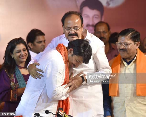 Union Minister M Venkaiah Naidu greets BJP Delhi Pradesh President Manoj Tiwari after MCD results at party office on April 26 2017 in New Delhi India...