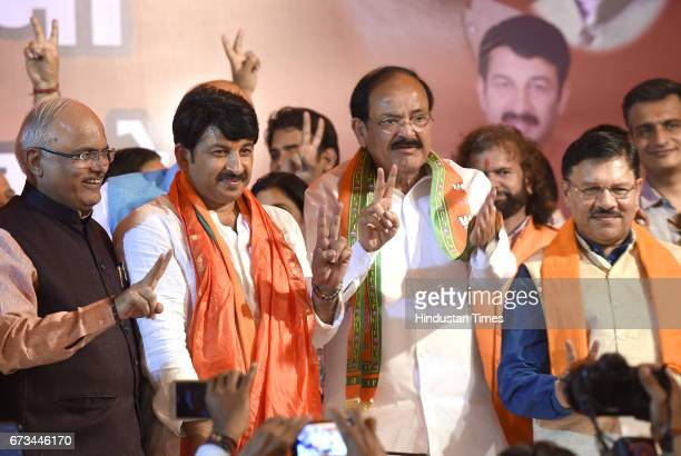 Union Minister M Venkaiah Naidu with BJP Delhi Pradesh President Manoj Tiwari after MCD results during a press conference at party office on April 26...