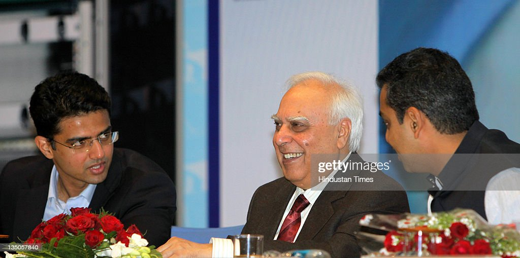 Union Minister of Communications and Information Technology Kapil Sibal along with Ministers of State <a gi-track='captionPersonalityLinkClicked' href=/galleries/search?phrase=Sachin+Pilot&family=editorial&specificpeople=5839798 ng-click='$event.stopPropagation()'>Sachin Pilot</a> and Milind Deora participate during an event for 'transfer of technology to Indian Telecom Manufacturers for GPON' by C-DOT on December 5, 2011 in New Delhi, India.