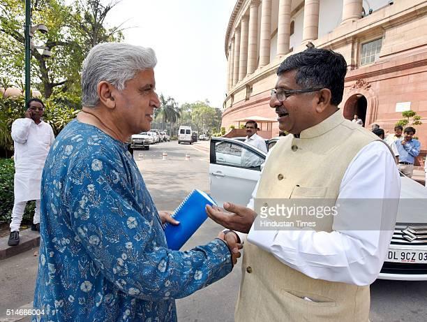 Union Minister of Communications and Information Technology Ravi Shankar Prasad talking to Rajya Sabha MP and poet lyricist and scriptwriter Javed...