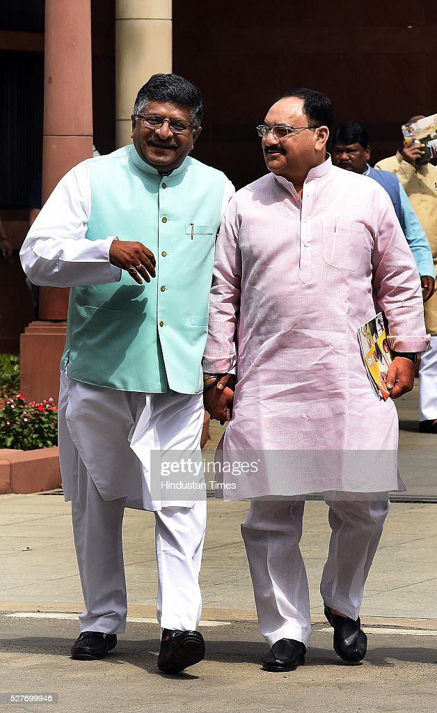 Union Minister of Health and Family Welfare Jagat Prakash Nadda ( JP Nadda) talking with Union Minister of Communications and Information Technology, Ravi Shankar Prasad after attending BJP parliamentary Board Meeting at Parliament Library on May 3, 2016 in New Delhi, India. With the BJP mounting an offensive against Congress vice-president on the AgustaWestland VVIP chopper bribery case, Rahul Gandhi on Wednesday said he is happy to be targeted.