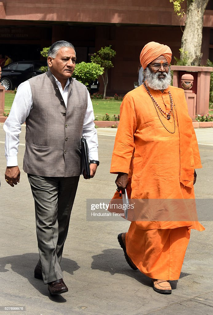 Union Minister of State Development of North Eastern Region (Independent Charge), External Affairs, Overseas Indian Affairs General V.K. Singh and BJP member of parliament from the Unnao Sakshi Maharaj Leave after attending BJP parliamentary Board Meeting at Parliament Library on May 3, 2016 in New Delhi, India. With the BJP mounting an offensive against Congress vice-president on the AgustaWestland VVIP chopper bribery case, Rahul Gandhi on Wednesday said he is happy to be targeted.