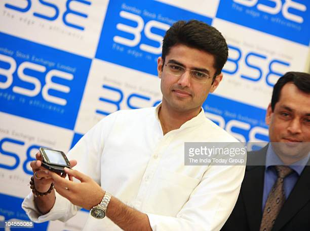 Union Minister of state for Communication and Information Technology Sachin Pilot shows mobile trading introduced by Bombay Stock Exchange in Mumbai...