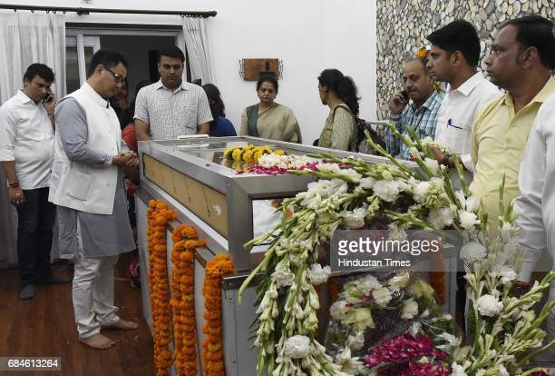 Union Minister of State for Home Affairs Kiren Rijiju paying their last respect to Union Environment Minister Anil Madhav Dave at his residence at...