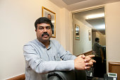 Union Minister of State for Petroleum and Natural Gas Dharmendra Pradhan poses for a profile during an interview at his office on July 3 2014 in New...