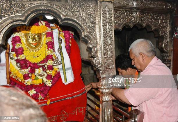 Union Minister of State for Railways Manoj Sinha offering prayer at Baba Kaal Bhairav Temple on March 18 2017 in Varanasi India Sinha who is three...
