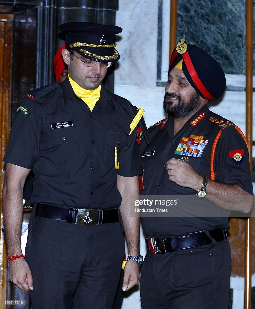 'NEW DELHI, INDIA- SEPTEMBER 6: Union Minister Sachin Pilot with Chief of the Army Staff, General Bikram Singh during the peeping ceremony where he has given commission as Lieutenant into the Territorial Army (TA) as a regular officer on September 6, 2012 in New Delhi, India. (Photo by Sanjeev Verma/Hindustan Times via Getty Images)'