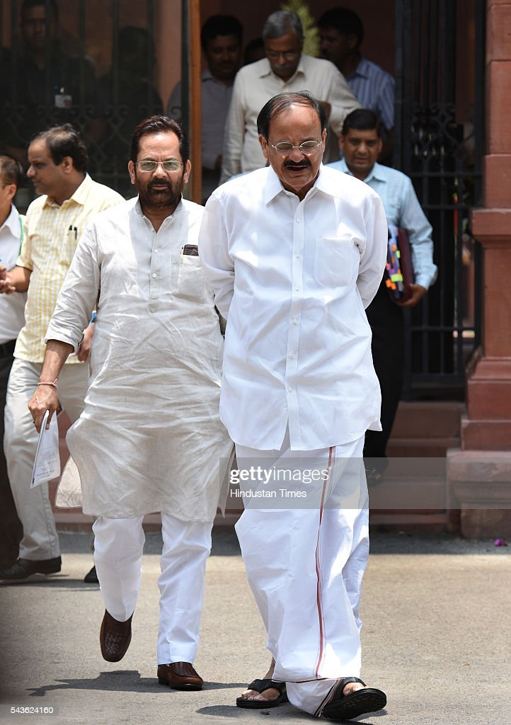 Union Minister Vankaiyah Naidu and Mukhtar Abbas Naqvi coming out after attending the Cabinet Meet at South Block, Raisina Hills on June 29, 2016 in New Delhi, India. The Cabinet, headed by Prime Minister Narendra Modi cleared the recommendations of the 7th Pay Commission according to which the overall hike in salary and allowance of central government employees and pensioners comes to 23.5 percent.