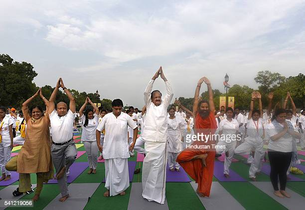 Union Minister Venkaiah Naidu and Yoga Guru Baba Ramdev and many others perform yoga during the rehearsals for the upcoming International Yoga Day at...