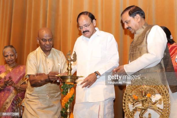 Union Ministers M Venkaiah Naidu and Mahesh Sharma during the Kuchipudi Rangapravesham of Atisha Pratap Singh daughter of Union Minister Rajiv Pratap...