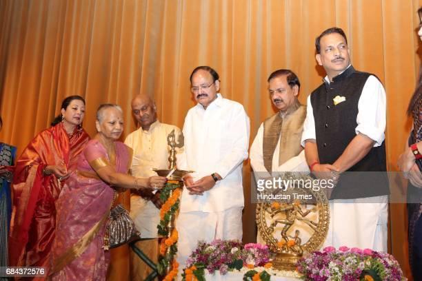 Union Ministers M Venkaiah Naidu Rajiv Pratap Rudy and Mahesh Sharma during the Kuchipudi Rangapravesham of Atisha Pratap Singh daughter of Union...