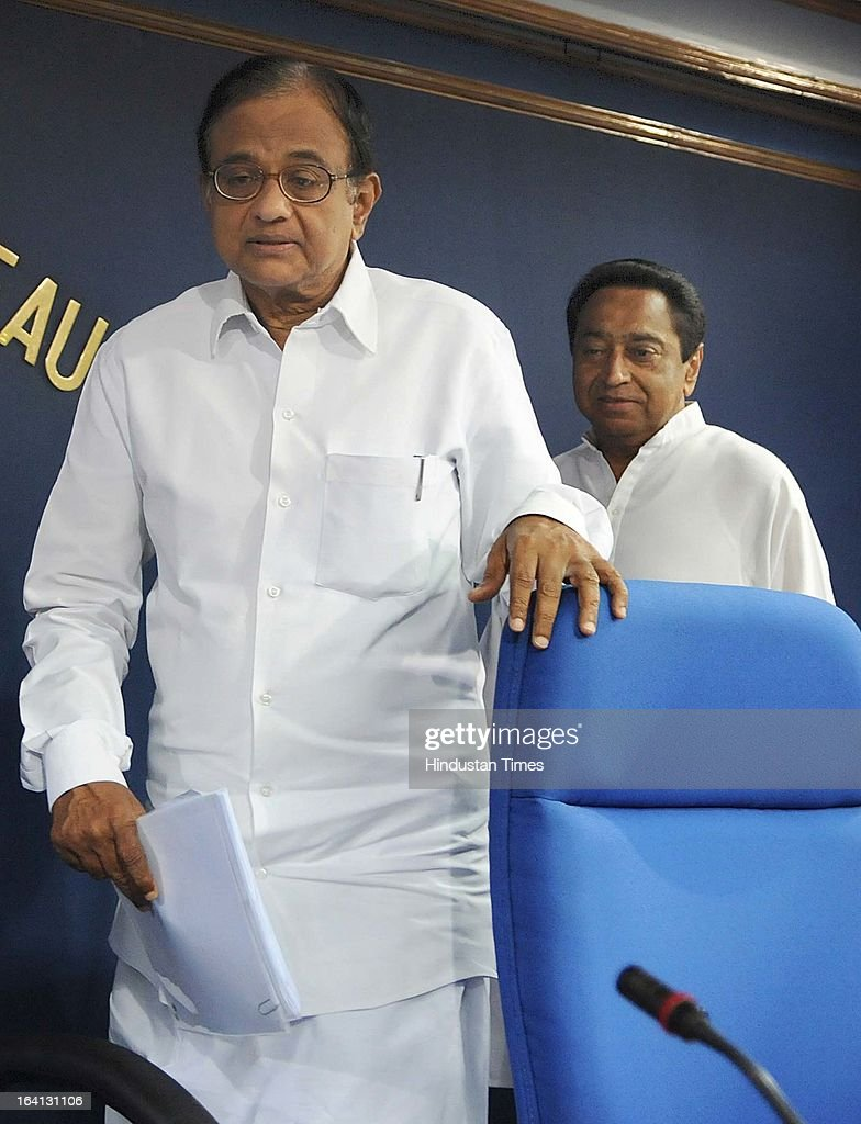 Union Ministers P Chidambaram and Kamal Nath arrive conference hall attending a press conference on withdrawal of support by DMK from UPA government over Sri Lanka issue on March 20, 2013 in New Delhi, India. The government today said that it will move amendments to the resolution on Sri Lanka at the UNHRC by sending a resolute message and denied New Delhi diluted the US-sponsored motion denouncing Sri Lanka over alleged rights abuses.