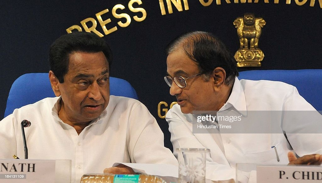 Union Ministers P Chidambaram, talking with Kamal Nath during a press conference on withdrawal of support by DMK from UPA government over Sri Lanka issue on March 20, 2013 in New Delhi, India. The government today said that it will move amendments to the resolution on Sri Lanka at the UNHRC by sending a resolute message and denied New Delhi diluted the US-sponsored motion denouncing Sri Lanka over alleged rights abuses.