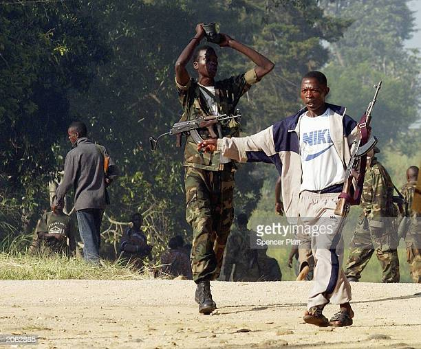 Union of the Congolese Patriots soldiers fight Lendus near the United Nations compound June 7 2003 in Bunia Democratic Republic of Congo French...