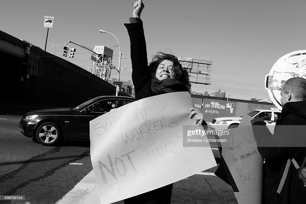 A union organizer celebrates after a driver refuses to cross a pucket line outside of Sunny Day car wash Car wash workers go on strike and form a...