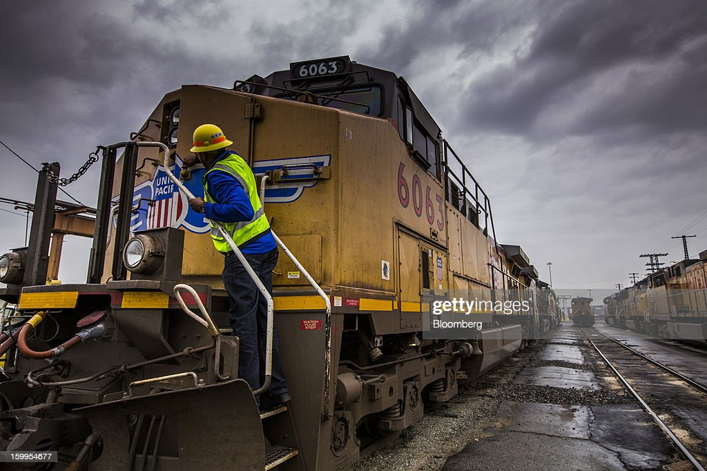 Union Pacific Corp. employee Jeff Smith closes the entry door on a rail car at the company's facility at the Port of Oakland in Oakland, California, U.S., on Wednesday, Jan. 23, 2013. Union Pacific Corp., the largest U.S. railroad by sales, is scheduled to report fourth-quarter earnings results on Jan. 24 before the opening of U.S. financial markets. Photographer: Ken James/Bloomberg via Getty Images